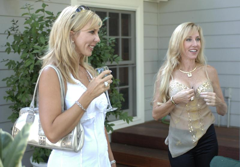 "This undated publicity photo provided by Bravo shows Vicki Gunvalson, left, and Kimberly Bryant in a scene from ""Party"" in Bravo's season one of ""The Real Housewives of Orange County."" When Gunvalson first appeared on the first season of ""The Real Housewives,"" she was married with two teenagers and sold insurance from home. She's now a first-time grandmother with her own insurance company and 12 employees. (AP Photo/Bravo, Jamie Trueblood)"