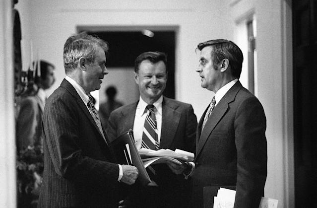 <p>Vice President Walter Mondale right, pauses during his day at the White House, Monday, July 19, 1977 to chat with secretary of State Cyrus Vance, left, and Dr. Zbigniew Brzezinski, assistance to the President for national security affairs. (Photo: AP) </p>