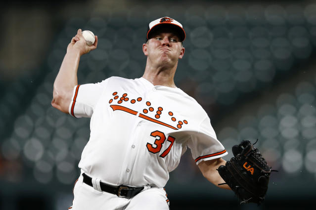 Baltimore Orioles starting pitcher Dylan Bundy throws to the Toronto Blue Jays in the first inning of a baseball game, Tuesday, Sept. 18, 2018, in Baltimore. (AP Photo/Patrick Semansky)