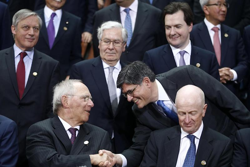 U.S. Treasury Secretary Jack Lew, right, shakes hands with German's Finance Minister Wolfgang Schaeuble during a group photo of the G20 finance ministers and central bank governors on the sidelines of their meeting at World Bank Group International Monetary Fund Spring Meetings in Washington, Friday, April 19, 2013. Also pictured are Britain's Chancellor of the Exchequer George Osborne, top right, and Bank of England Gov. Mervyn King, top row center. (AP Photo/Charles Dharapak)