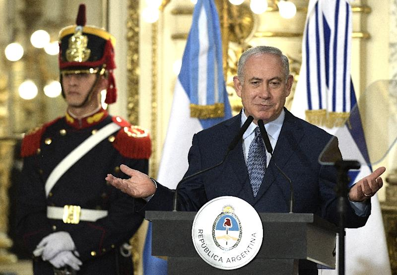Israeli Prime Minister Benjamin Netanyahu (R) delivers a speech after a working meeting at the Casa Rosada presidential house in Buenos Aires (AFP Photo/JUAN MABROMATA)