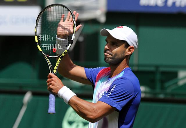 Colombia's Alejandro Falla celebrates winning against Germany's Peter Gojowczyk during the quarterfinal match at the Gerry Weber Open tennis tournament in Halle, Germany, Friday, June 13, 2014. Falla won the match with 7-6 and 7-6. (AP Photo/dpa, Oliver Krato)