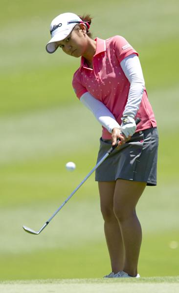 Ai Miyazato, of Japan, chips onto the ninth green in the third round of the LPGA LOTTE Championship golf tournament at Ko Olina Golf Club, Friday, April 20, 2012, in Kapolei, Hawaii. (AP Photo/Eugene Tanner)