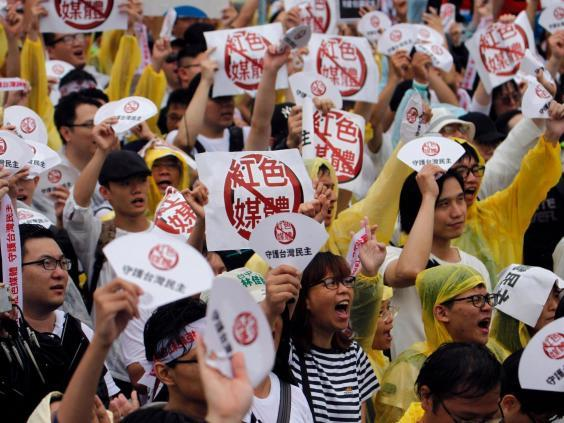 A rally against pro-China media in Taipei in June last year (Getty)