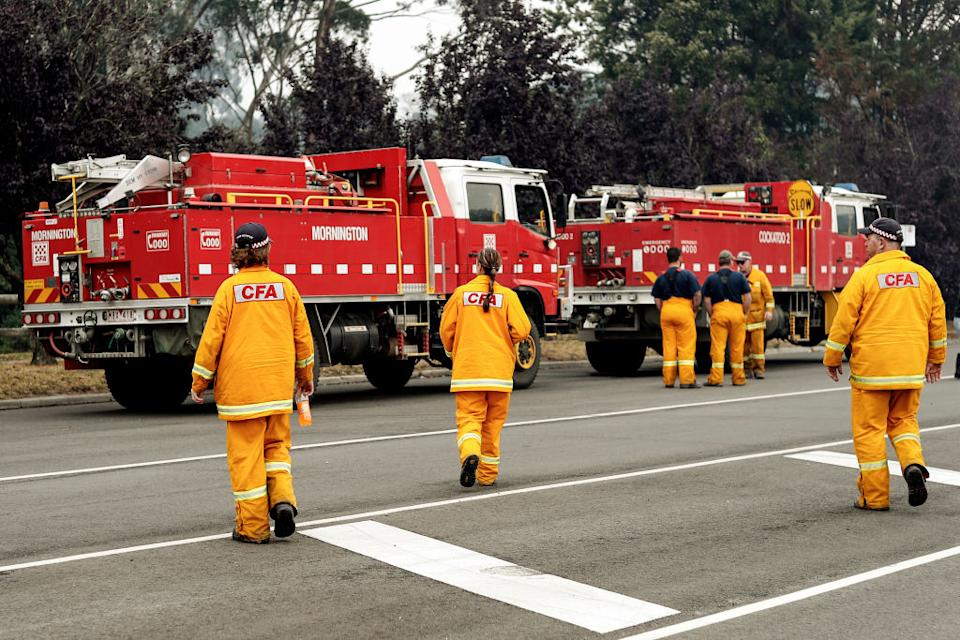 CANN RIVER AUSTRALIA - JANUARY 06: Strike team firefighters prepare to roll out on January 06, 2020 in Cann River, Australia. Milder weather conditions have provided some relief for firefighters in Victoria as bushfires continue to burn across the East Gippsland area, as clean up operation and evacuations continue. Two people have been confirmed dead and four remain missing. More than 923,000 hectares have been burnt across Victoria, with hundreds of homes and properties destroyed. 14 people have died in the fires in NSW, Victoria and South Australia since New Year's Eve. (Photo by Darrian Traynor/Getty Images)