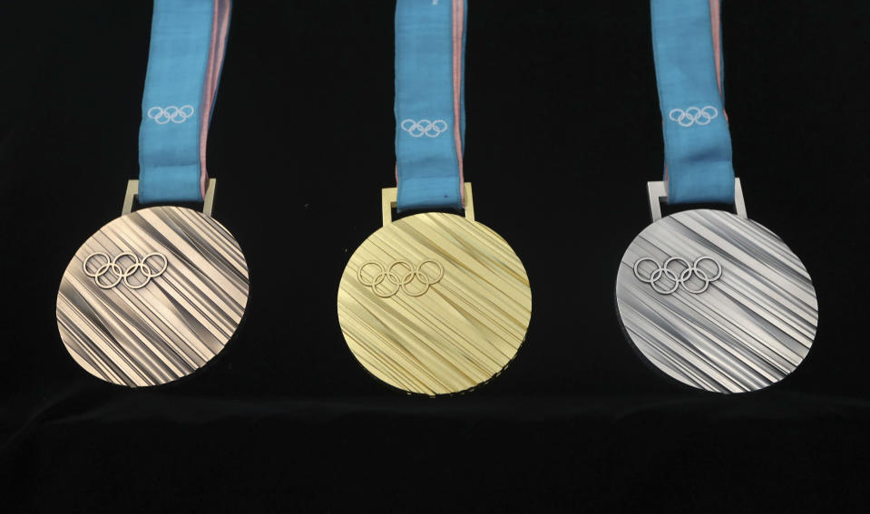 From left, the bronze, gold and silver medals for the PyeongChang 2018 Winter Olympics. (AP)