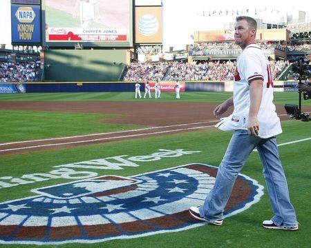 Atlanta Braves Chipper Jones walks onto the field to throw out the first pitch during the opening day ceremonies prior to their MLB National League baseball game against the Philadelphia Phillies at Turner Field in Atlanta, Georgia April 1, 2013. REUTERS/Tami Chappell