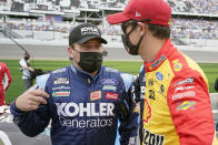 Ryan Newman, left, and Joey Logano talk on pit road before the NASCAR Daytona 500 auto race at Daytona International Speedway, Sunday, Feb. 14, 2021, in Daytona Beach, Fla. (AP Photo/John Raoux)