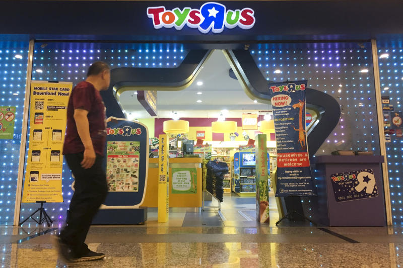 A Man Walks In Front Of The Toys R Us Store At A Shopping Mall In
