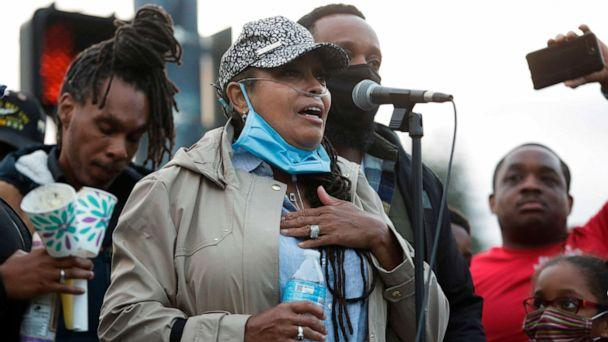 PHOTO: Marcia Carter-Patterson speaks during a vigil at the intersection where her son Manuel Ellis, a 33-year-old black man, died in Tacoma Police custody on March 3 and was recently ruled a homicide. (Jason Redmond/AFP via Getty Images)