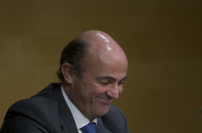 Spain's Finance Minister Luis de Guindos smiles during a joint news conference with he European Commissioner for Monetary Affairs Olli Rehn, unseen in Madrid Monday Jan. 28, 2013. Battling to reduce a swollen deficit and avoid a bailout, the year-old conservative government has brought major financial and labor reforms and applied severe cutbacks in wages and spending but so far the economy has shown few signs of recovery. (AP Photo/Paul White)