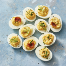 """<p>A deviled egg is the perfect cross between a hard-boiled and soft-boiled egg; and this batch can be prepared a few days in advance of a busy Monday morning. Master this recipe before moving on to other variations.</p><p><em><a href=""""https://www.goodhousekeeping.com/food-recipes/a48179/best-deviled-eggs-recipe/"""" rel=""""nofollow noopener"""" target=""""_blank"""" data-ylk=""""slk:Get the recipe for Scallion Bacon Deviled Eggs »"""" class=""""link rapid-noclick-resp"""">Get the recipe for Scallion Bacon Deviled Eggs »</a></em></p>"""