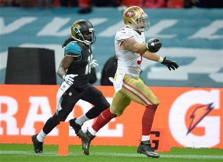San Francisco 49ers outside linebacker Dan Skuta (51) returns a fumble for a touchdown against the Jacksonville Jaguars in the second half during an International Series game at Wembley Stadium. Mandatory Credit: Bob Martin-USA TODAY Sports