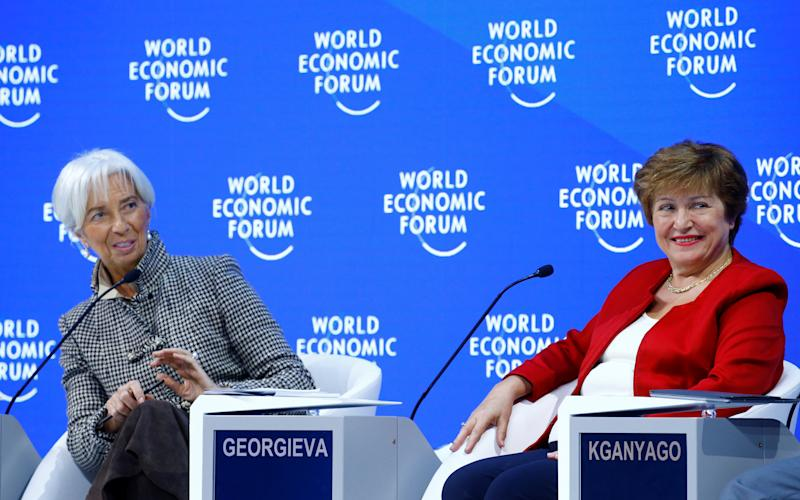 World Bank CEO Kristalina Georgieva and International Monetary Fund (IMF) Managing Director Christine Lagarde take part in a panel discussion during the World Economic Forum (WEF) annual meeting in Davos, Switzerland, January 25, 2019. REUTERS/Arnd Wiegmann