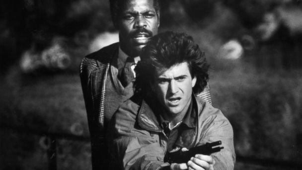 PHOTO: Danny Glover stands behind Mel Gibson in a scene from the film 'Lethal Weapon,' 1987. (Warner Brothers/Getty Images)