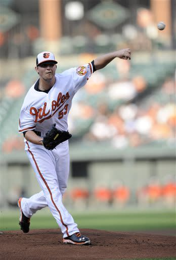 Baltimore Orioles starting pitcher Zach Britton (53) delivers against the Cleveland Indians during the first inning of a baseball game, Monday, June 24, 2013, in Baltimore. (AP Photo/Nick Wass)