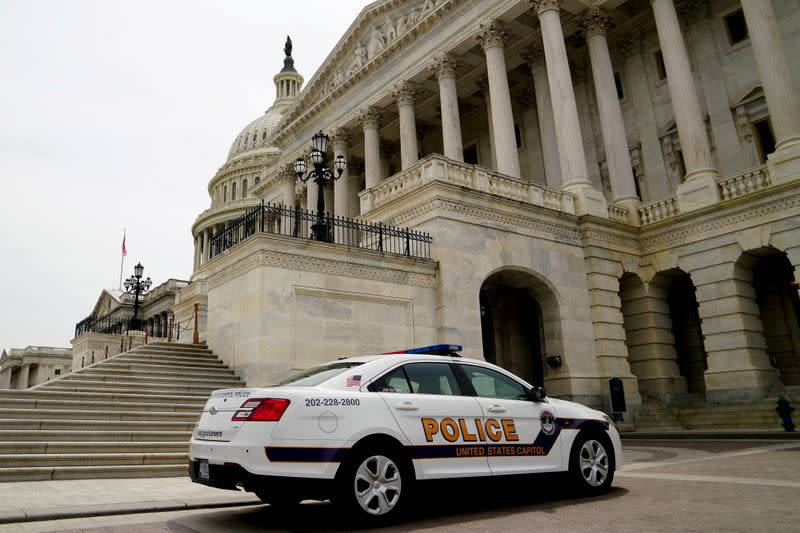 FILE PHOTO: A Capitol Police vehicle parks at the U.S. Capitol in Washington