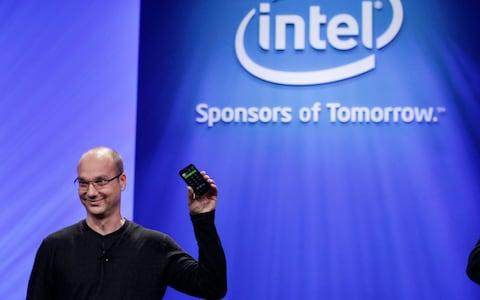 In this Tuesday, Sept. 13, 2011 file photo, Google Senior Vice President of Mobile, Andy Rubin, holds up a Google Android phone running on an Intel chip at the Intel Developer Forum in San Francisco - Credit: Paul Sakuma/AP