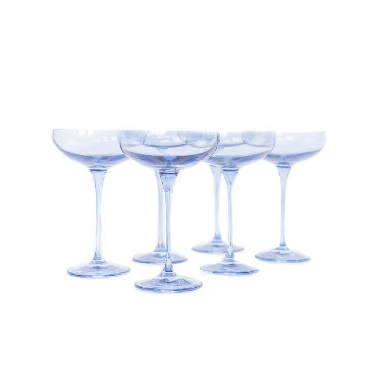 """<p><strong>Estelle Colored Glass</strong></p><p>westelm.com</p><p><strong>$195.00</strong></p><p><a href=""""https://go.redirectingat.com?id=74968X1596630&url=https%3A%2F%2Fwww.westelm.com%2Fproducts%2Flcl-estelle-colored-glass-champagne-coupe-d9580%2F&sref=https%3A%2F%2Fwww.redbookmag.com%2Flife%2Fg37132424%2F30th-birthday-party-ideas%2F"""" rel=""""nofollow noopener"""" target=""""_blank"""" data-ylk=""""slk:Shop Now"""" class=""""link rapid-noclick-resp"""">Shop Now</a></p><p>If you're done with ye olde bar-hopping days (or can just make a mean cocktail), invite some pals over for drinks at home! A set of stunning coupe glasses will really elevate the experience, too.</p>"""