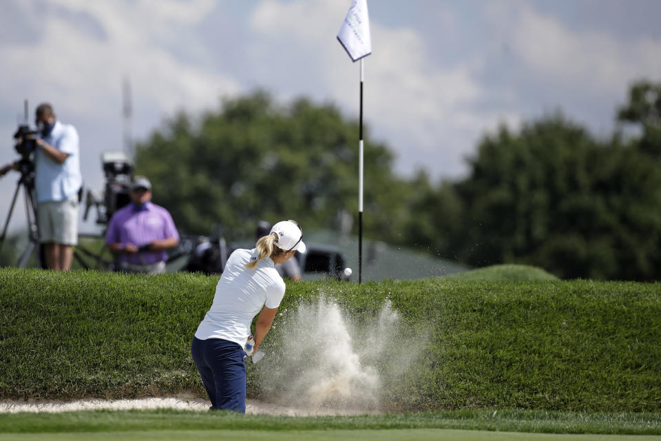 Danielle Kang hits out of a bunker on the fifth hole during the first round of the LPGA Drive On Championship golf tournament at Inverness Golf Club in Toledo, Ohio, Friday, July 31, 2020. (AP Photo/Gene J. Puskar)
