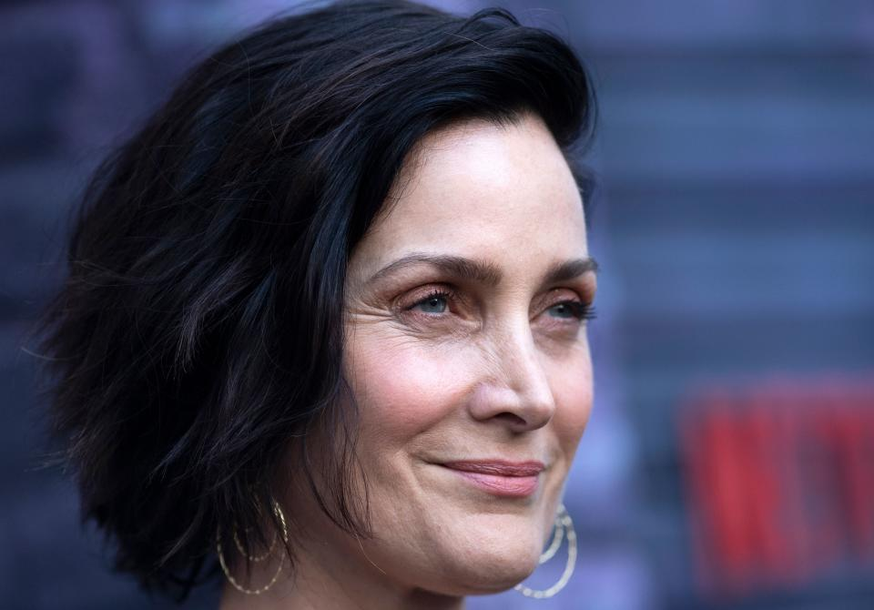 Carrie-Anne Moss says she was treated differently in Hollywood after turning 40. (Photo: VALERIE MACON/AFP via Getty Images)