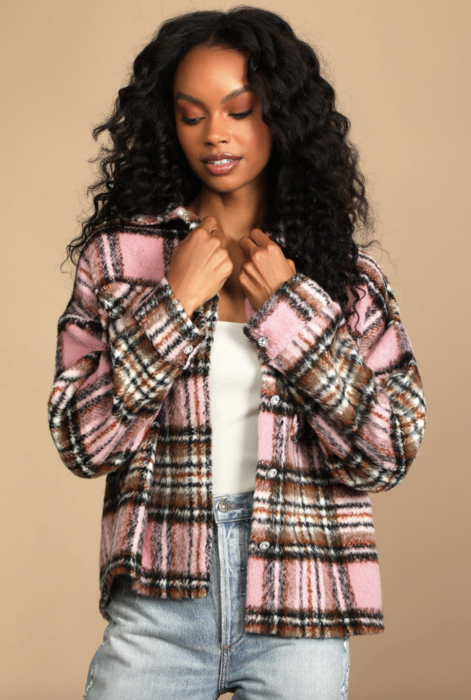 black model with curly hair posing in The City is Calling Pink Plaid Shacket