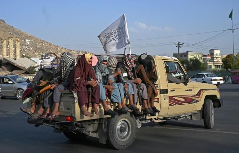 Taliban fighters patrol the streets of Kabul