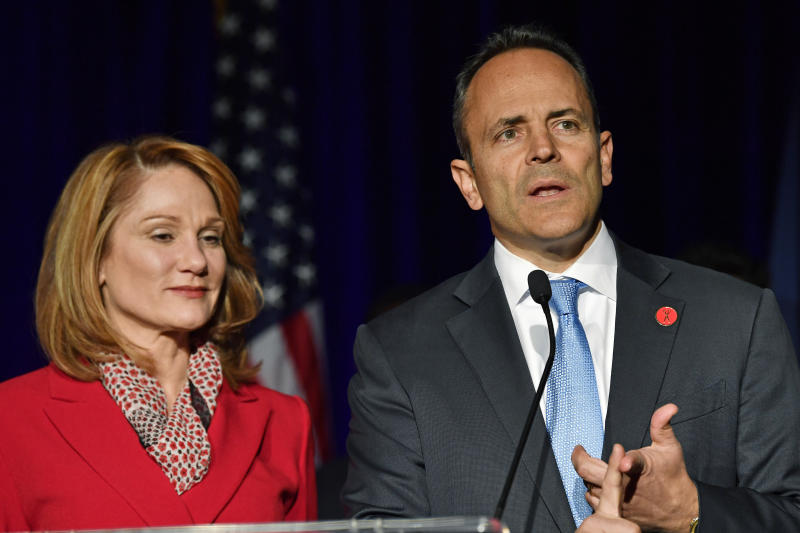 "Kentucky Gov. Matt Bevin, right, and his wife, Glenna, speak to supporters gathered at a Republican Party event in Louisville, Ky., Tuesday, Nov. 5, 2019. Bevin did not concede the race to his opponent, electing to ""wait and see what happens."" (AP Photo/Timothy D. Easley)"