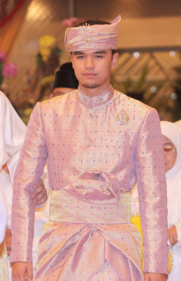 """<div class=""""caption-credit""""> Photo by: Wenn.com</div><div class=""""caption-title""""></div>The cost of clothing for such a series of events is enormous. Here, the groom, Pengiran Haji Muhammad Ruzaini, wears a formal outfit that Tiampo says """"cost $10,000, off-the-cuff."""" The fabric, she says, appears to be pineapple fiber woven with golden thread. """"The pineapple fibers are a bit sheer,"""" she says, """"and in warmer climates people want to wear something that's cool but formal. With the gold thread it would be in the hundreds of dollars a yard."""" <br>"""