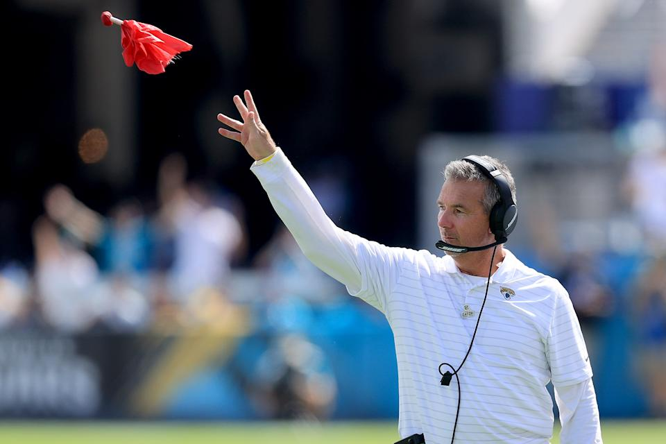 JACKSONVILLE, FLORIDA - OCTOBER 10: Head coach Urban Meyer of the Jacksonville Jaguars throws the red challenge flag during the game against the Tennessee Titans at TIAA Bank Field on October 10, 2021 in Jacksonville, Florida. (Photo by Sam Greenwood/Getty Images)