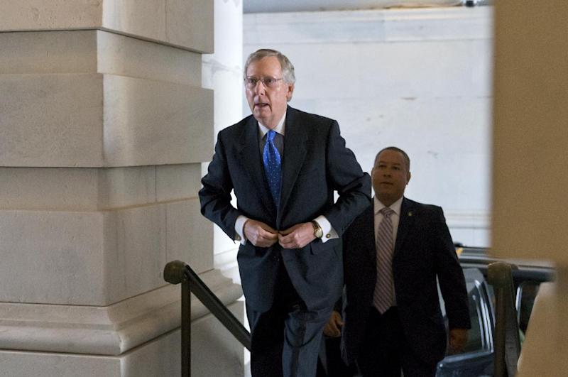 Senate Minority Leader Mitch McConnell, R-Ky., arrives at the Capitol in Washington, Wednesday, Oct. 16, 2013. Aides to Senate Democrat Majority Leader Harry Reid and Republican Minority Leader Mitch McConnell said the leaders resumed talks Tuesday night and voiced optimism about striking an agreement Wednesday that could pass both houses of Congress and reach President Barack Obama's desk before Thursday, when the U.S. Treasury says it will begin running out of cash. (AP Photo/J. Scott Applewhite)
