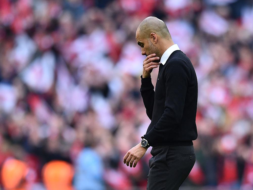 Guardiola has not lived up to his billing in his first year at City: Getty