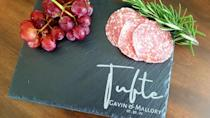 <p>The <span>Personalized Slate Charcuterie Board</span> ($19, and up) is perfect for making their cheese boards look stunning. It's modern and sleek, perfect for the one with a contemporary aesthetic. </p>