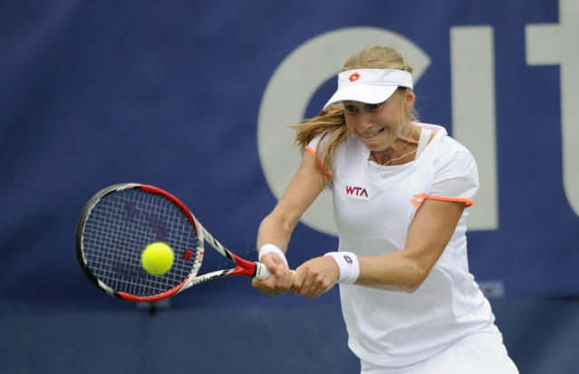 Ekaterina Makarova, of Russia, returns the ball against Anastasia Pavlyuchenkova, of Russia, during a match at the Citi Open tennis tournament, Friday, Aug. 1, 2014, in Washington. (AP Photo/Nick Wass)