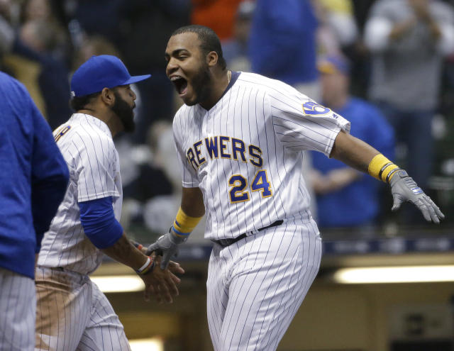 Milwaukee Brewers' Jesus Aguilar celebrates after hitting a walk-off home run in the team's baseball game against the Miami Marlins on Saturday, April 21, 2018, in Milwaukee. The Brewers won 6-5. (AP Photo/Aaron Gash)
