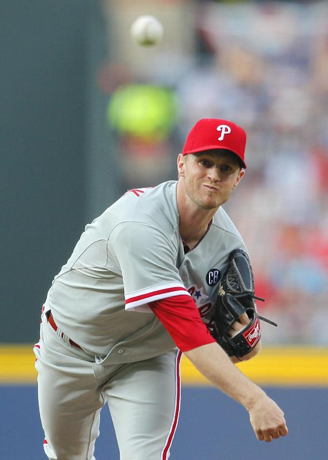Philadelphia Phillies starting pitcher Kyle Kendrick delivers in the first inning of a baseball game against the Atlanta Braves Tuesday, June 17, 2014, in Atlanta. (AP Photo/Todd Kirkland)