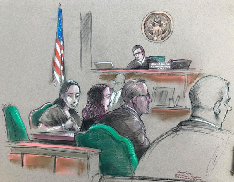 In this artist sketch, Yujing Zhang, left, listens to a hearing on Monday. (Daniel Pontet via AP)