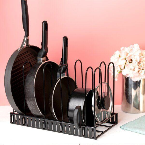 """<p><strong>Rebrilliant</strong></p><p>wayfair.com</p><p><a href=""""https://go.redirectingat.com?id=74968X1596630&url=https%3A%2F%2Fwww.wayfair.com%2Fkitchen-tabletop%2Fsb0%2Fpot-racks-c415184.html%3Fredir_sku%3DW000260443&sref=https%3A%2F%2Fwww.delish.com%2Fkitchen-tools%2Fcookware-reviews%2Fg36277927%2Fway-day-kitchen-deals-2021%2F"""" rel=""""nofollow noopener"""" target=""""_blank"""" data-ylk=""""slk:Shop Now"""" class=""""link rapid-noclick-resp"""">Shop Now</a></p><p><strong><del>$50</del> $34 (32% off)</strong></p><p>Though it's intended to be used for storage, we love this freestanding rack for drying pans, saucers and lids when cleaning up after a big meal. </p>"""