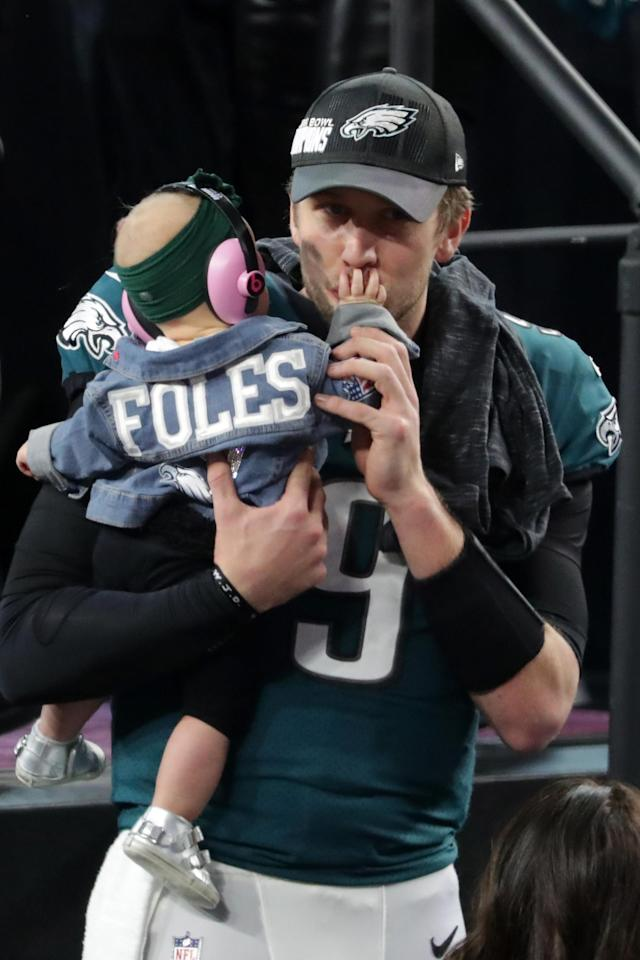 <p>Nick Foles #9 of the Philadelphia Eagles celebrates with his daughter Lily Foles after his 41-33 victory over the New England Patriots in Super Bowl LII at U.S. Bank Stadium on February 4, 2018 in Minneapolis, Minnesota. The Philadelphia Eagles defeated the New England Patriots 41-33. (Photo by Streeter Lecka/Getty Images) </p>