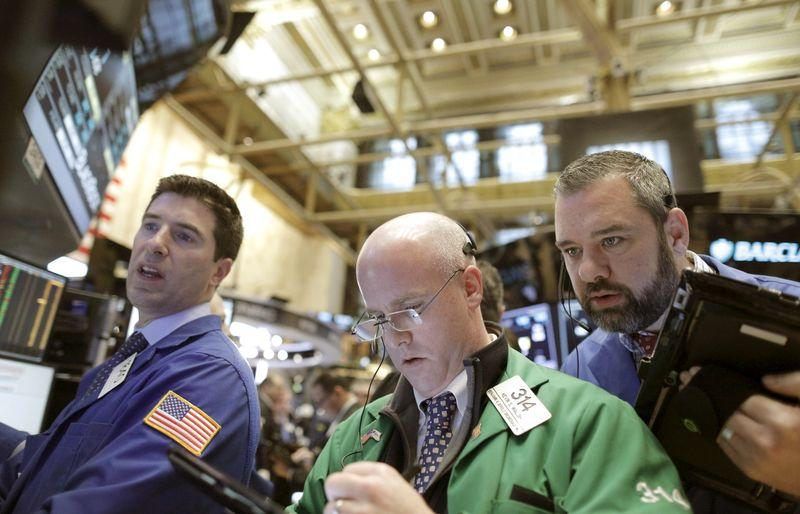Traders work on the main trading floor of the New York Stock Exchange shortly after the opening bell of the trading session in New York