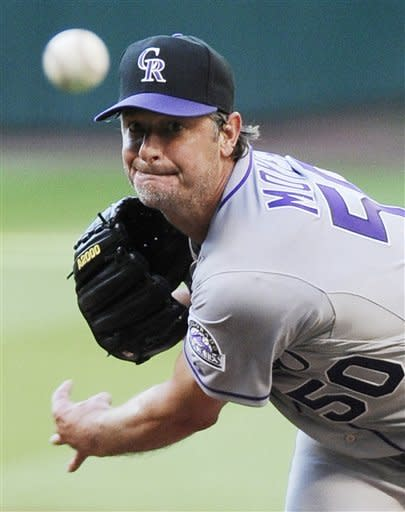 Colorado Rockies' Jamie Moyer delivers a pitch in the second inning of a baseball game against the Houston Astros Saturday, April 7, 2012, in Houston. (AP Photo/Pat Sullivan)
