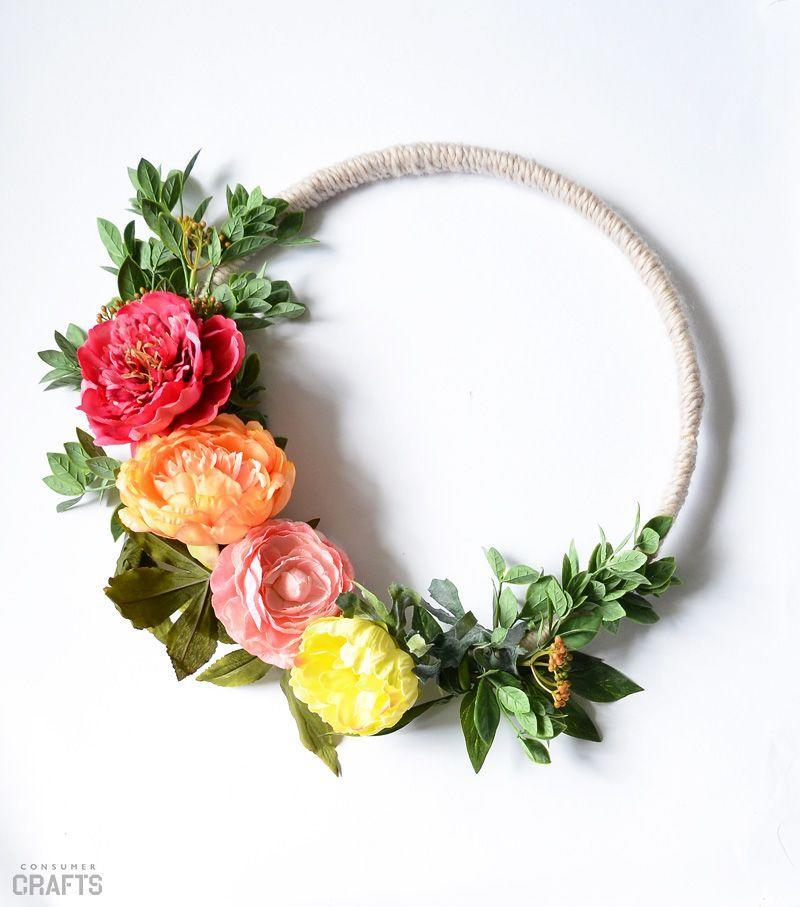 "<p>Instead of the usual wreath form, this project uses a yarn-wrapped embroidery hoop for a more delicate look.</p><p><strong>Get the tutorial at <a href=""http://blog.consumercrafts.com/decor-home/summer-yarn-wrapped-wreath/"" rel=""nofollow noopener"" target=""_blank"" data-ylk=""slk:Crafts Unleashed"" class=""link rapid-noclick-resp"">Crafts Unleashed</a>.</strong></p><p><a class=""link rapid-noclick-resp"" href=""https://www.amazon.com/Embroidery-Hoops/b?ie=UTF8&node=262621011&tag=syn-yahoo-20&ascsubtag=%5Bartid%7C10050.g.4395%5Bsrc%7Cyahoo-us"" rel=""nofollow noopener"" target=""_blank"" data-ylk=""slk:SHOP EMBROIDERY HOOPS"">SHOP EMBROIDERY HOOPS</a><br></p>"