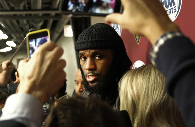 "Cavaliers superstar <a class=""link rapid-noclick-resp"" href=""/nba/players/3704/"" data-ylk=""slk:LeBron James"">LeBron James</a> talks to reporters. (AP)"