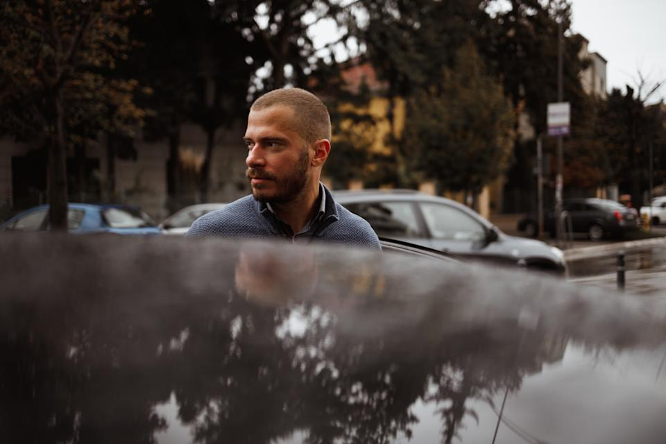 A  man getting out of the car. Source: Getty Images