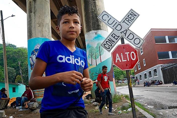 Justin Soler 12, alongside the train tracks in Coatzacoalcos in Veracruz state, a migrant hub en route to the U.S. border. Many Migrants try to hitch rides here on passing freight trains, a dangerous effort, they often get maimed or killed. Many sleep by the tracks. These are often the poorest migrants as they cannot afford smugglers or other transport. The international aid group Doctors Without Borders provides periodic medical aid and some basic necessities at a site alongside the tracks and below a highway bridge.