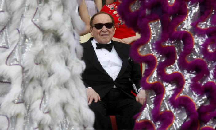 Sheldon Adelson watches the opening ceremony of the Sands Cotai Central in Macau on April 12, 2012.