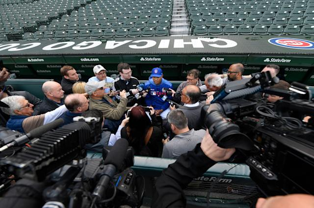 """Chicago Cubs shortstop Addison Russell speaks to the media in the dugout before a baseball game against the <a class=""""link rapid-noclick-resp"""" href=""""/mlb/teams/miami/"""" data-ylk=""""slk:Miami Marlins"""">Miami Marlins</a>. Russell rejoins the team after completing a 40-game suspension for violating Major League Baseball's domestic violence policy and spending extra time in the minors to get ready. (AP)"""