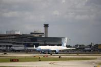 Air Force Two arrives at Tampa International Airport with Vice President Mike Pence on Wednesday Aug. 5, 2020, who came to the Tampa Bay area with plans to visit the Hilton Clearwater Beach Resort & Spa in Clearwater as part of his 'Faith in America' tour. (Douglas R. Clifford/Tampa Bay Times via AP)