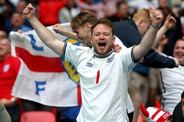 England fans celebrate the first goal