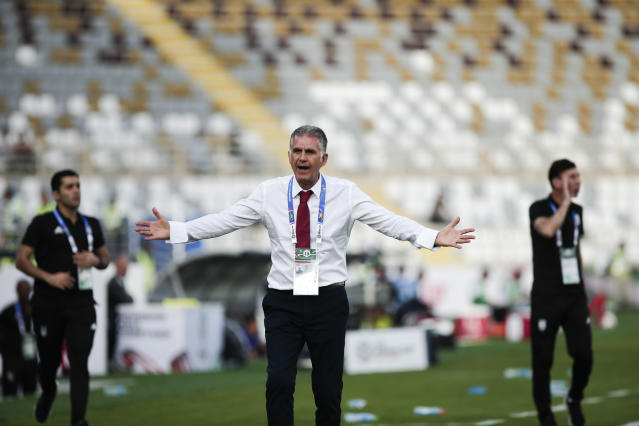 Iran's head coach Carlos Queiroz argues with a line referee during the AFC Asian Cup group D soccer match between Iran and Vietnam at Al Nahyan Stadium in Abu Dhabi, United Arab Emirates, Saturday, Jan. 12, 2019. (AP Photo/Nariman El-Mofty)